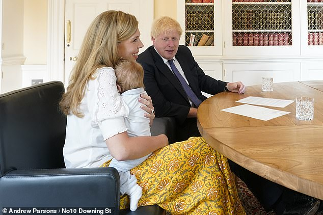 It's our boy: Boris Johnson, Carrie Symonds and Wilfred in Downing Street last year