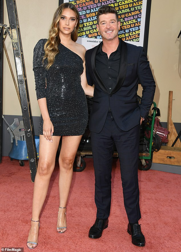Happy couple: Luca Patrick is Geary's third child with Thicke, who shares a son with his former wife Paula Patton; the couple are seen at the Once Upon A Time In Hollywood premiere in 2019