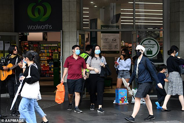 Sydney residents wearing face masks take to the streets of the CBD for shopping
