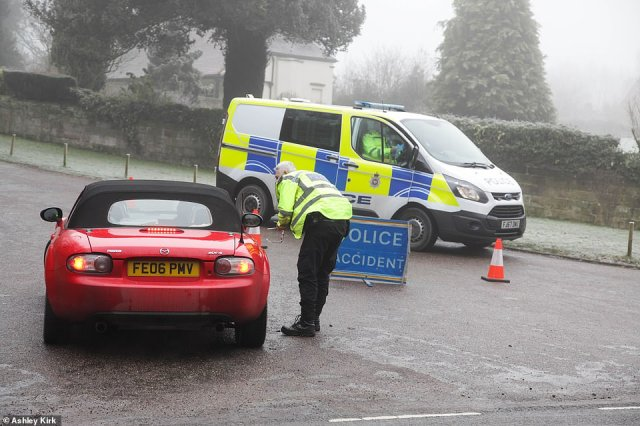 Derbyshire police were pictured turning drivers away at a vehicle checkpoint at Calke Abbey, near Ticknall, Friday afternoon