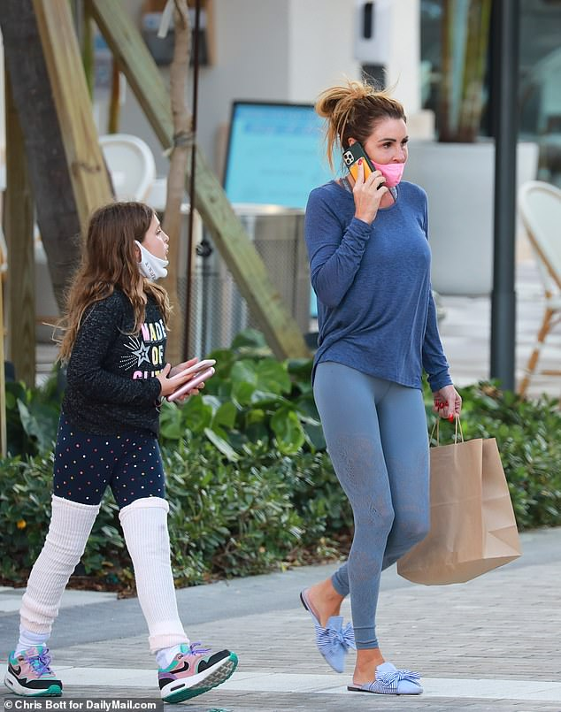 Uchitel is pictured here with her daughter, while walking around in Palm Beach, Florida
