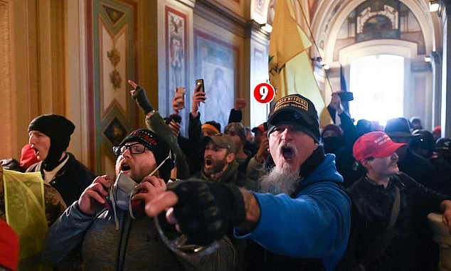 A man pictured wearing an Oath Keepers hat in the U.S. Capitol on Wednesday