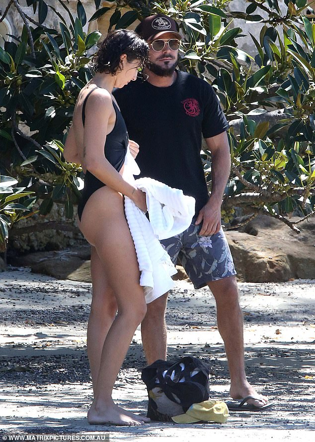 New love: Byron Bay local seemed to have his beau delighted with her beauty as they chatted on the sand