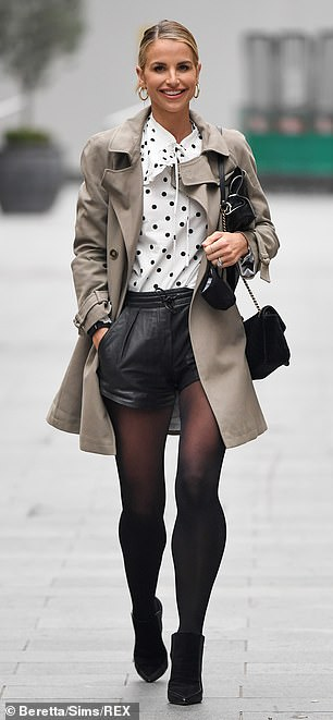 Smile: The star showed off her toned legs in high-waisted black shorts paired with sheer tights and sky-high boots