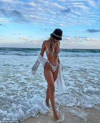 Francesca Farago parades her lithe tanned frame as she steps out of the ocean after signing PLT deal