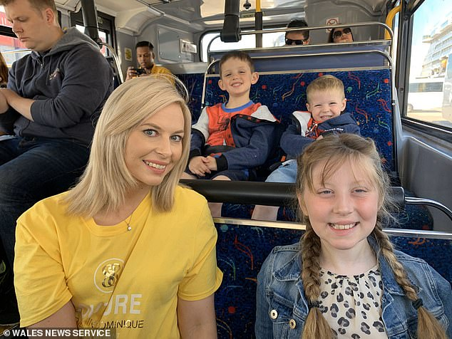 Eva's father and mother Carran Williams (pictured together with brothers in background) say her cancer had progressed too far in the summer to be accepted for treatment on the trial