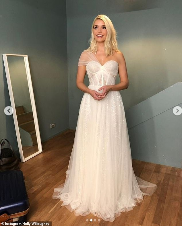 Wow:A sheer panel across the waist drew the eye to the host's trim waist while the bridal-inspired gown flowing into a showstopping tulle skirt