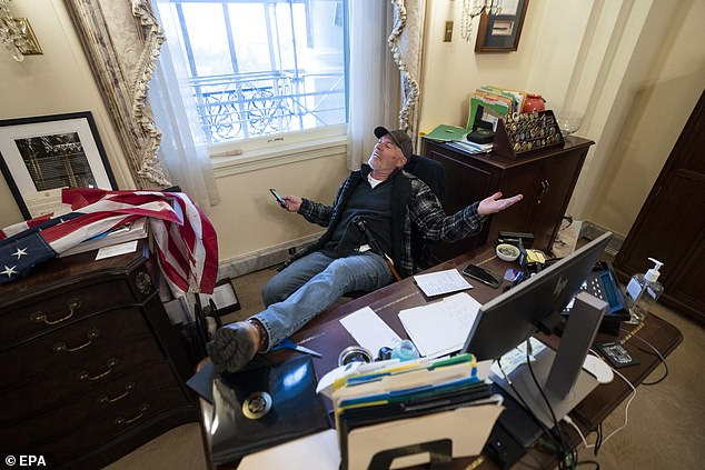 Others include Alabama man Lonnie Coffman, whose vehicle contained 11 Molotovs and Richard Barnett (pictured), from Arkansas, who was pictured sitting at a desk in Pelosi's office, according to a statement of the Ministry of Justice.