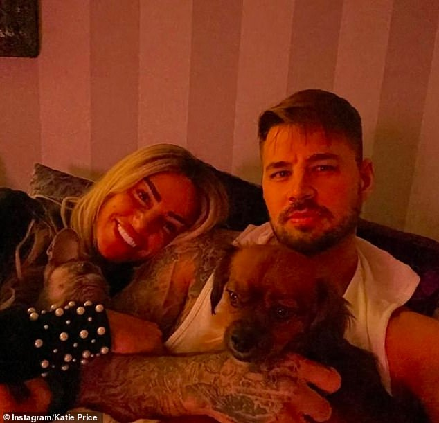 Smitten:But there did not appear to be trouble in paradise after the row, as Katie shared a sweet snap on Instagram of them cuddling up together on the sofa with their pet dog