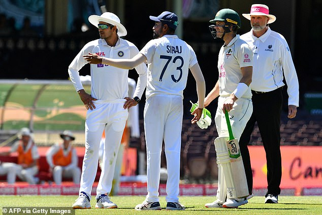 Indian cricket playerMohammed Siraj (centre) claimed on Sunday he was on the receiving end of racist remarks during day four of the third test between Australia and India