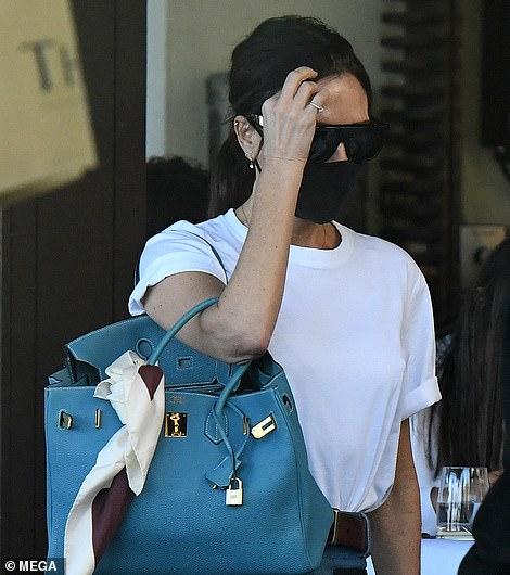 Victoria and David Beckham enjoy an al fresco lunch with Harper, Cruz and Romeo in Miami