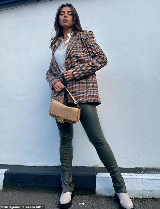 Stylish:The Love Island star, 25, looked stylish in the PrettyLittleThing checkered blazer, finishing her look with a buttoned-up white shirt