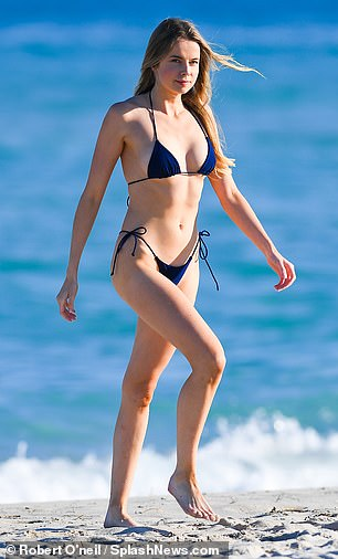 Looking good: Louisa ensured to work all her angles as she soaked up the sun during her beach trip