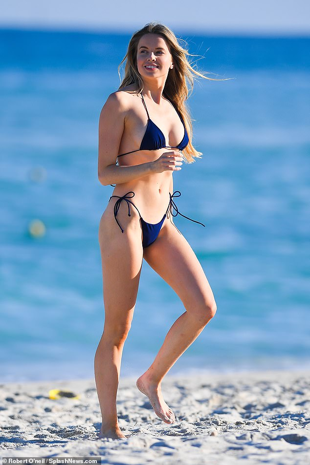 Sizzling: Louisa Warwick looked sensational as she flaunted her incredible figure in a tiny blue bikini while at the beach in Miami on Sunday