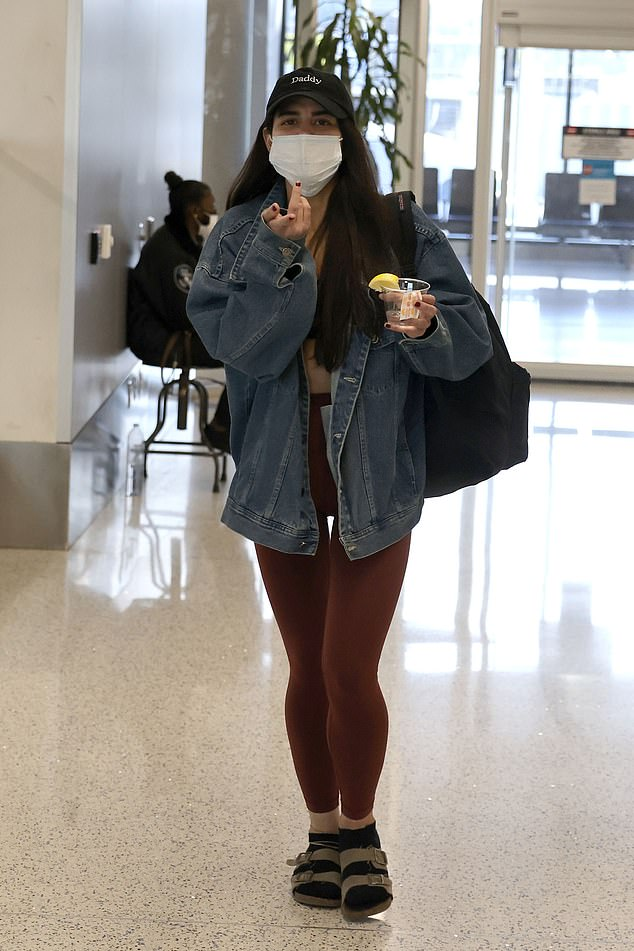'Soho Karen' Miya Ponsetto, 22, touched down at Los Angeles International Airport with a drink in hand on Sunday afternoon after leaving New York, where she was arraigned on assault charges forattacking 14-year-old Keyon Harrold Jr, claiming he stole her phone
