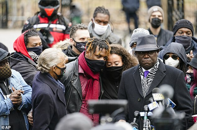 Harrold Sr and Keyon Jr's mother, Kat Rodriguez, held a rally in Manhattan for their son on Wednesday, alongside civil rights attorney Ben Crump (right) and Rev Al Sharpton (left)