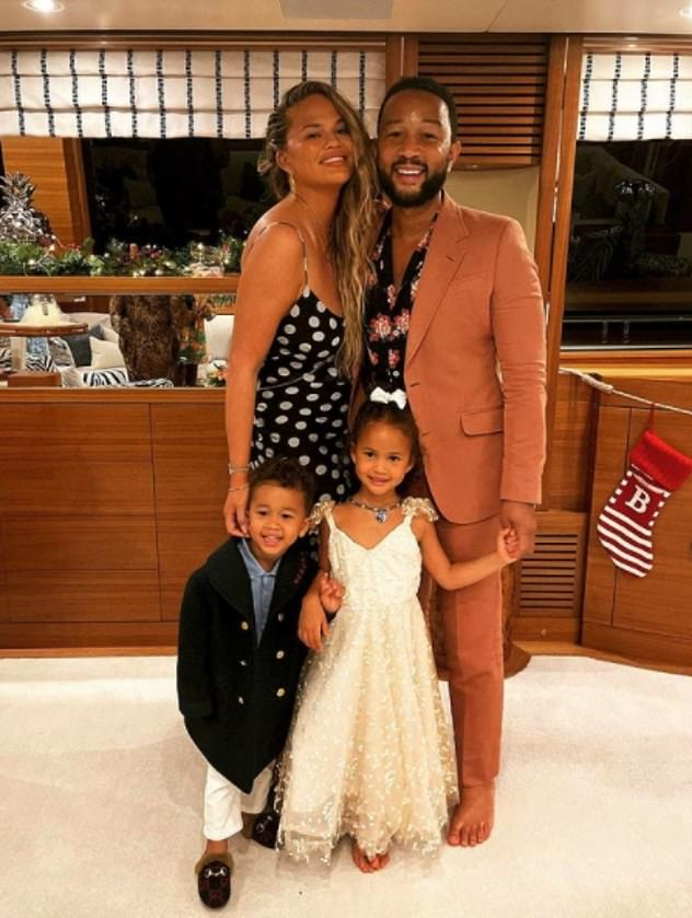 Festive getaway: Chrissy recently returned from a new year Caribbean vacation with husband John Legend and their children, Luna, four, and Miles, two (pictured on board their yacht)