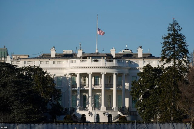 An American flag flies at half-staff above the White House in Washington on Sunday