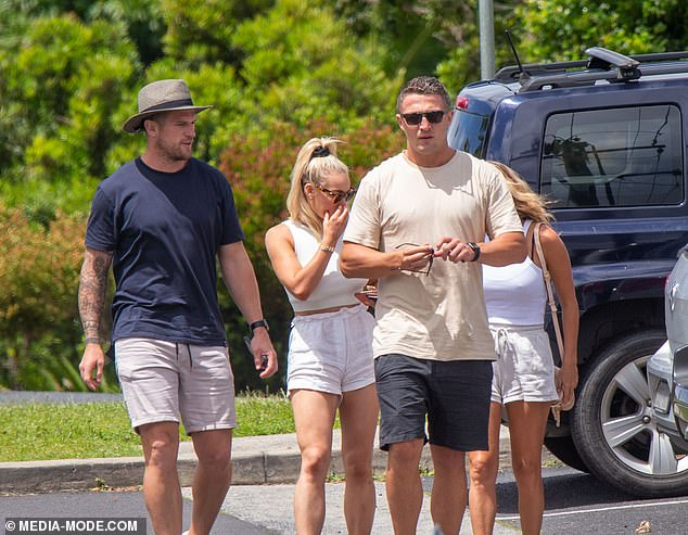 Keeping it casual: Dressed casually in a beige T-shirt and navy shorts, Sam was seen arriving with Jade at a café, where they were joined by Luke and Tori