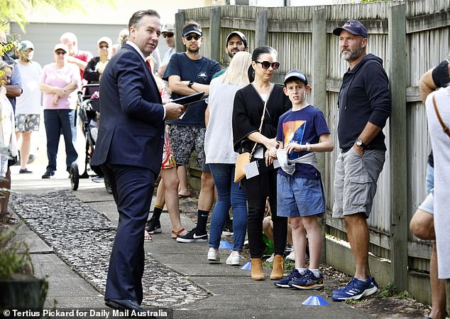 The proportion of Australians expecting house prices in their area to climb has almost quadrupled in just three months from five per cent in September to 19 per cent in December, a Finder survey showed. Pictured is a Brisbane house auction in 2020