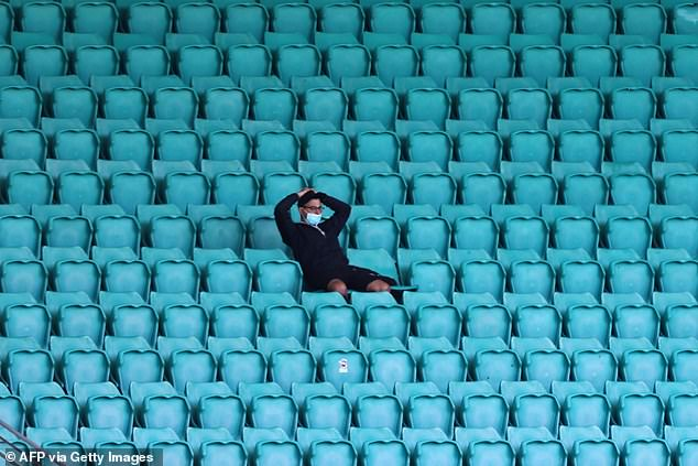 A spectator is seen wearing a face mask at the Sydney Cricket Ground after capacity was reduced due to the coronavirus pandemic
