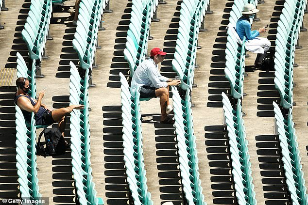 The Queensland government has reduced the crowd capacity for the final Test at the Gabba, which starts on Friday, to 50 per cent while making masks mandatory for any fans moving around the venue (pictured crowd at third Test at SCG)