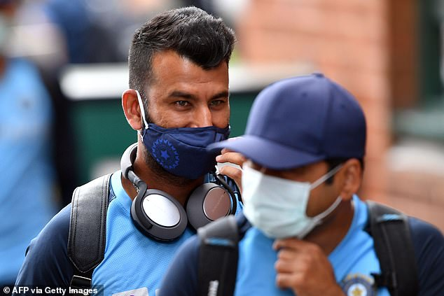 India's Cheteshwar Pujara arrives with teammates for a training session at the Sydney Cricket Ground last week