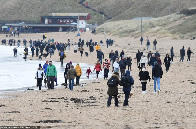 Flocks of people descended on to the beach in Tyneside.New Government guidelines dictate that daily exercise must be taken in one's local area - but it is unclear how far today's visitors traveled for a welcome breath of fresh air