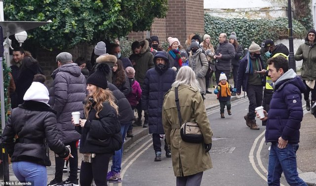 Pictured: People queue for pancakes in Hampstead, North London despite London Mayor Sadiq Khan declaring a state of emergency in the capital due to a rapid rise in cases