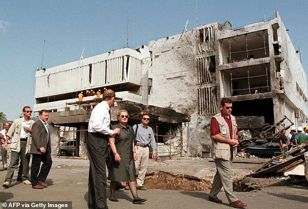 Then-US Secretary of State Madeleine Albright looks 18 August at damage from a bomb at the US embassy in Dar Es Salaam, Tanzania where 10 people were killed and 72 injured on Augustr 7, 1998