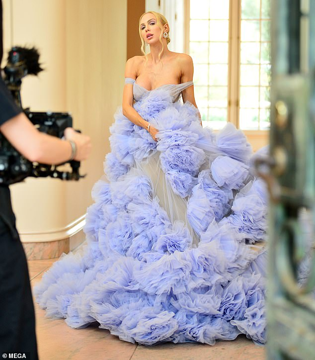 Two outfits:The 32-year-old reality star wore a short pink dress and a baby blue ballgown while posing for Cosmopolitan magazine in the upscale Bel Air area