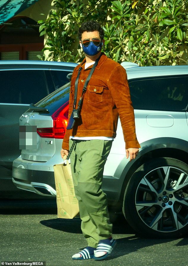 Sighting:Orlando Bloom cut a casual figure as he stepped out to fulfil his domestic duties at the supermarket in Santa Barbara, California on Sunday