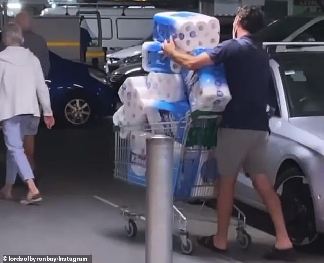 A man who was spotted wheeling a huge haul of toilet paper to his car was shamed on social media and wrongly accused of panic buying