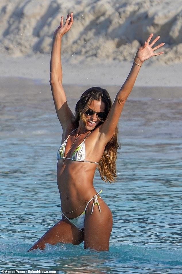 Stunning: Izabel Goulart looked like she was having the time of her life as she frolicked on the shores of Eden Rock Beach on the Caribbean island of St. Barts