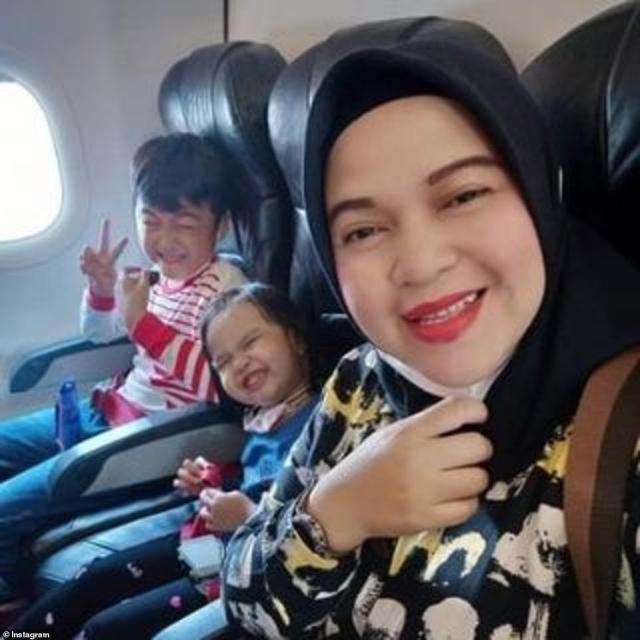 Ratih Windania posted a selfie with her three children laughing as they boarded a plane in Indonesia on Saturday in a heartbreaking final message