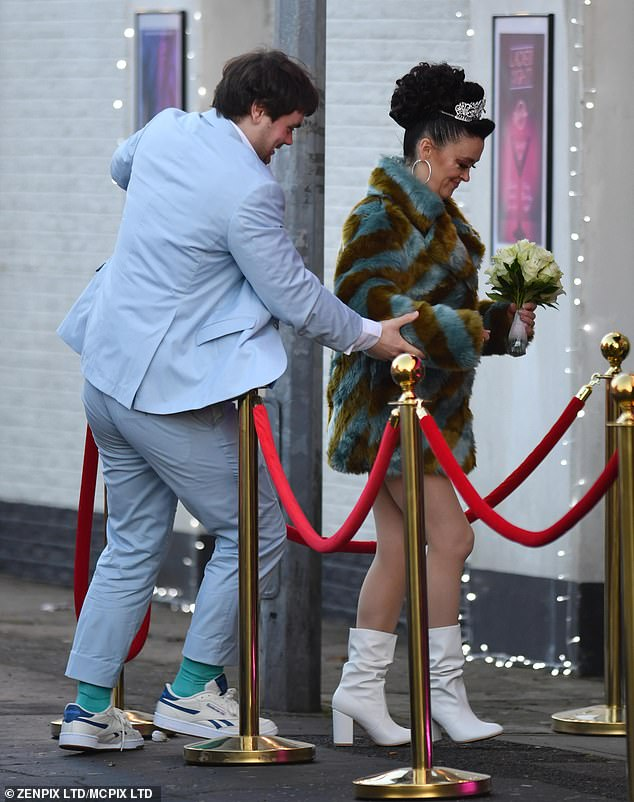 Sparkling: Bronagh completed her party outfit with a pair of short white boots and styled her brunette locks in a glamorous up-do, fixed with a glittering silver tiara