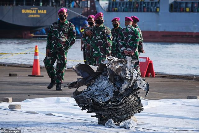 A piece of one of the engines sits on the dock awaiting examination by crash investigators as they scour the sea for wreckage and passengers