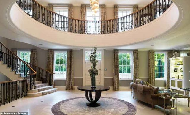 Making an entrance: The impressive hall that greets visitors on entry to the property, leading to the grand central staircase