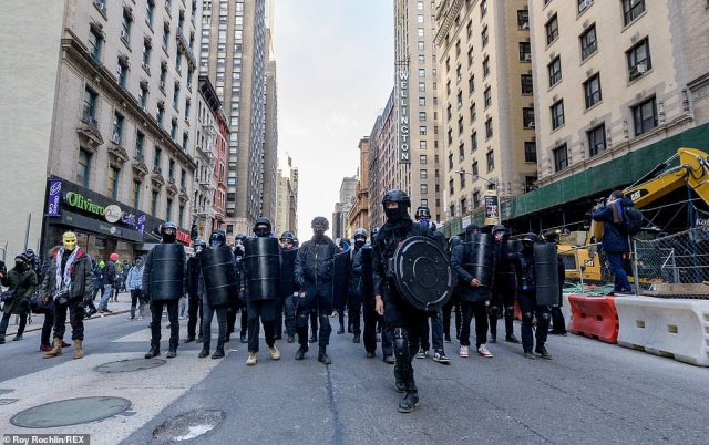 On the streets: A New York Antifa group praised the shield-bearing protesters who 'turned out, kept each other safe, marched, played music, chanted, and showed the world that the far-right is never, ever welcome here'