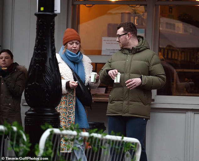 Pals: The chart topper appeared in a good mood as they engaged in a conversation with their pal while picking up a drink