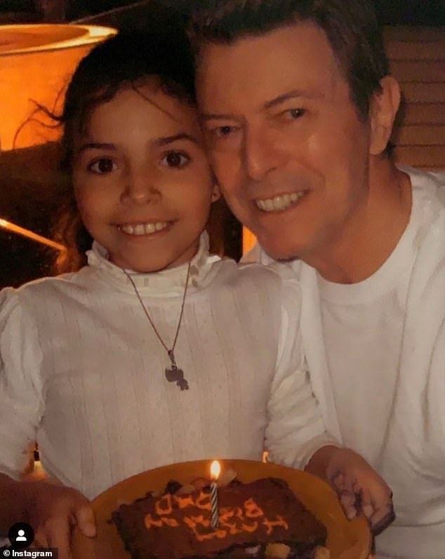 Adorable: David Bowie's daughter has paid tribute to her late father on what would have been his 71st birthday with a throwback snap