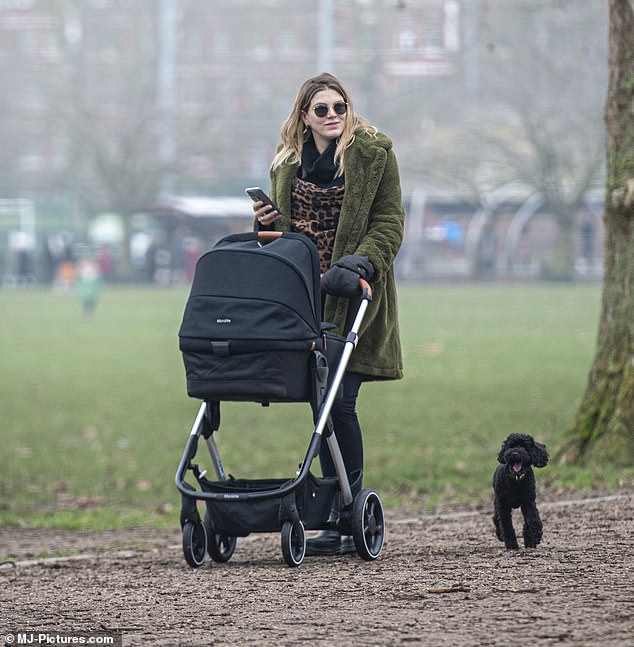 Multi-tasking: It was quite the family day for Ashley, who also walked her dog while getting some fresh air in lockdown