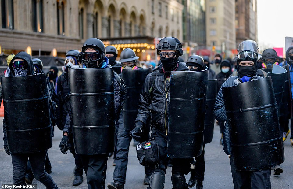 Equipped: The Antifa protesters brought helmets, goggles and matching riot shields to their march on Sunday, with some of them carrying Black Lives Matter paraphernalia