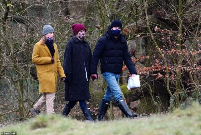 Matching: The happy couple coordinated their ensembles in blue jeans and tall wellies