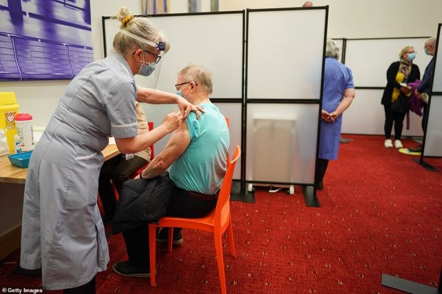 James Charlton receives the AstraZeneca/Oxford University Covid-19 vaccine at a mass vaccination hub in the Centre For Life in Newcastle