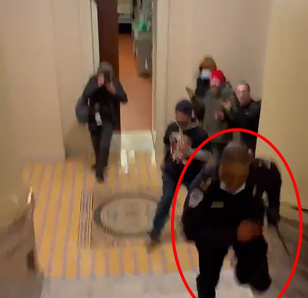 In a separate incident of the riot, Capitol cop Eugene Goodman is seen running away from the crowd, leading them out of the Senate.  He is hailed as a hero