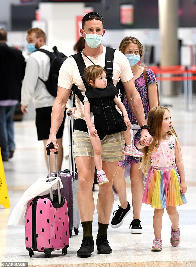 Western Australia's border closures have kept families apart. Pictured: A family at Brisbane Airport
