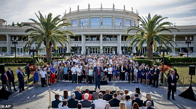 Another of the outstanding loans for was for the Trump National Doral in Miami. Trump is pictured, center