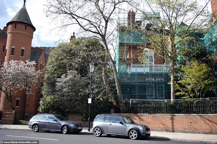 Jimmy Page's Tower House, left, and Robbie Williams' house, hidden by trees on Ilchester Place in West London