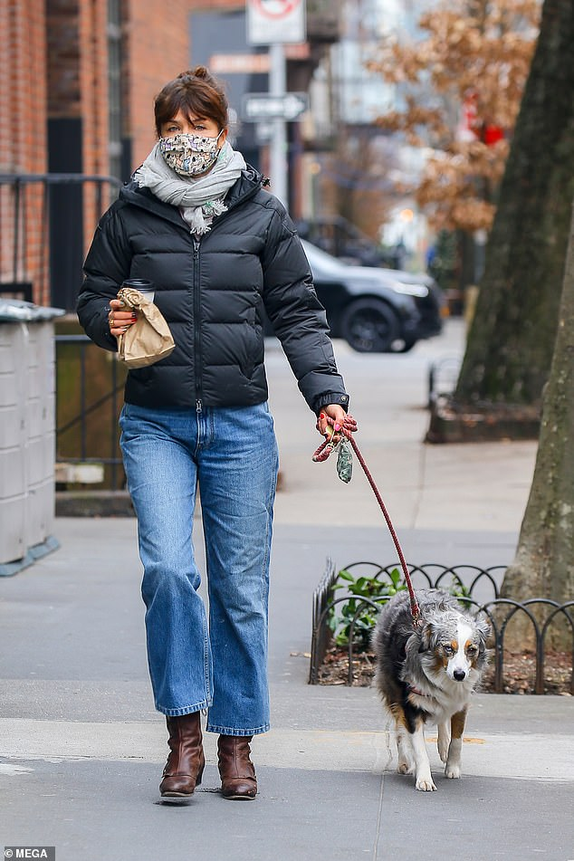From catwalk to dog walk: Helena Christensen wrapped up in a padded coat and bootcut jeans as she took her dog for a walk in New York on Monday